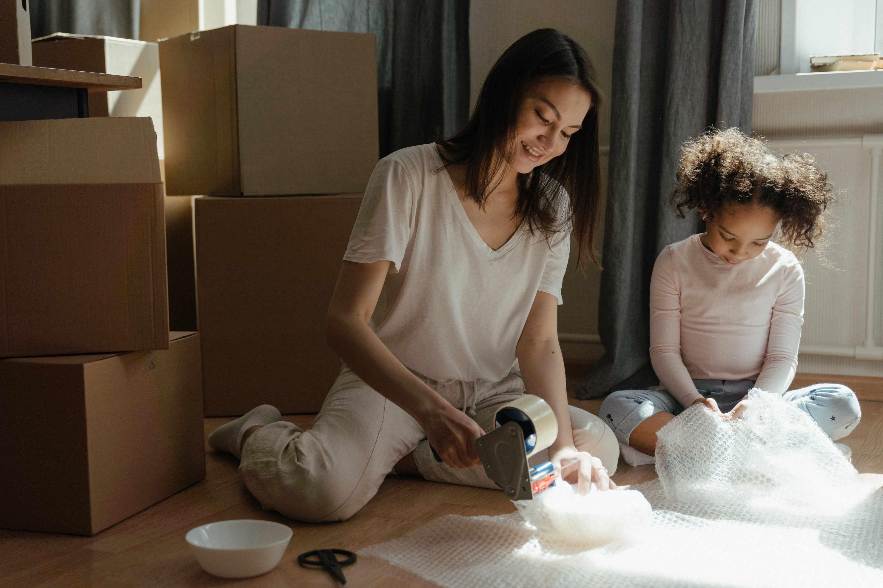 mom and daughter packing